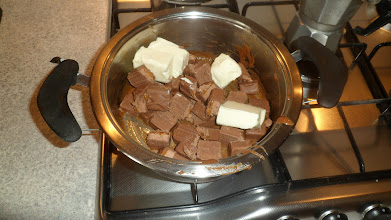 Photo: Chop the Milky Ways in small pieces and melt them in a small pot, with the butter.
