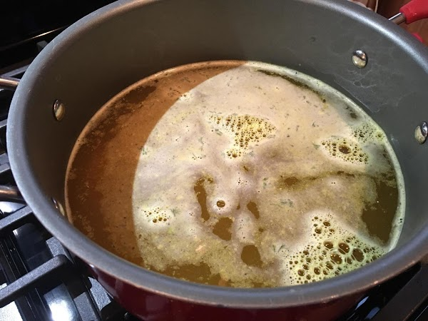 In a large Dutch oven or soup pot, add the cleaned chicken, thyme, salt,...