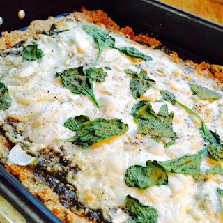 Quinoa & Buckwheat Crusted Pizza with Pesto, Spinach and Onions