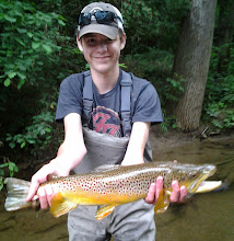 """Photo: You have got to be kidding! This kid is on fire....his 2nd 23"""" brown of the day. Better go play the lottery tonight Carson. Hats off also to his guide Lou Uecker!"""