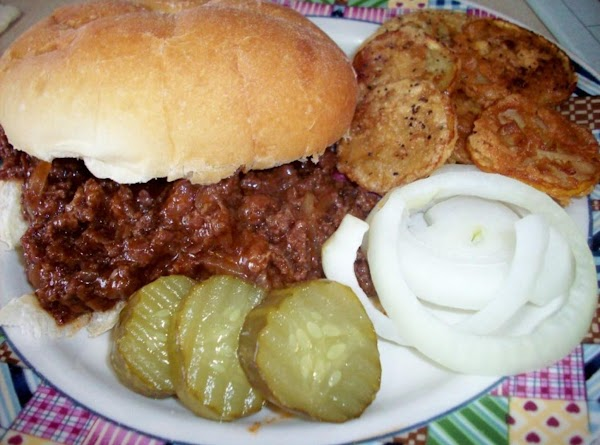 Fried yellow squash shown here with Sloppy Joes, picle & onion.