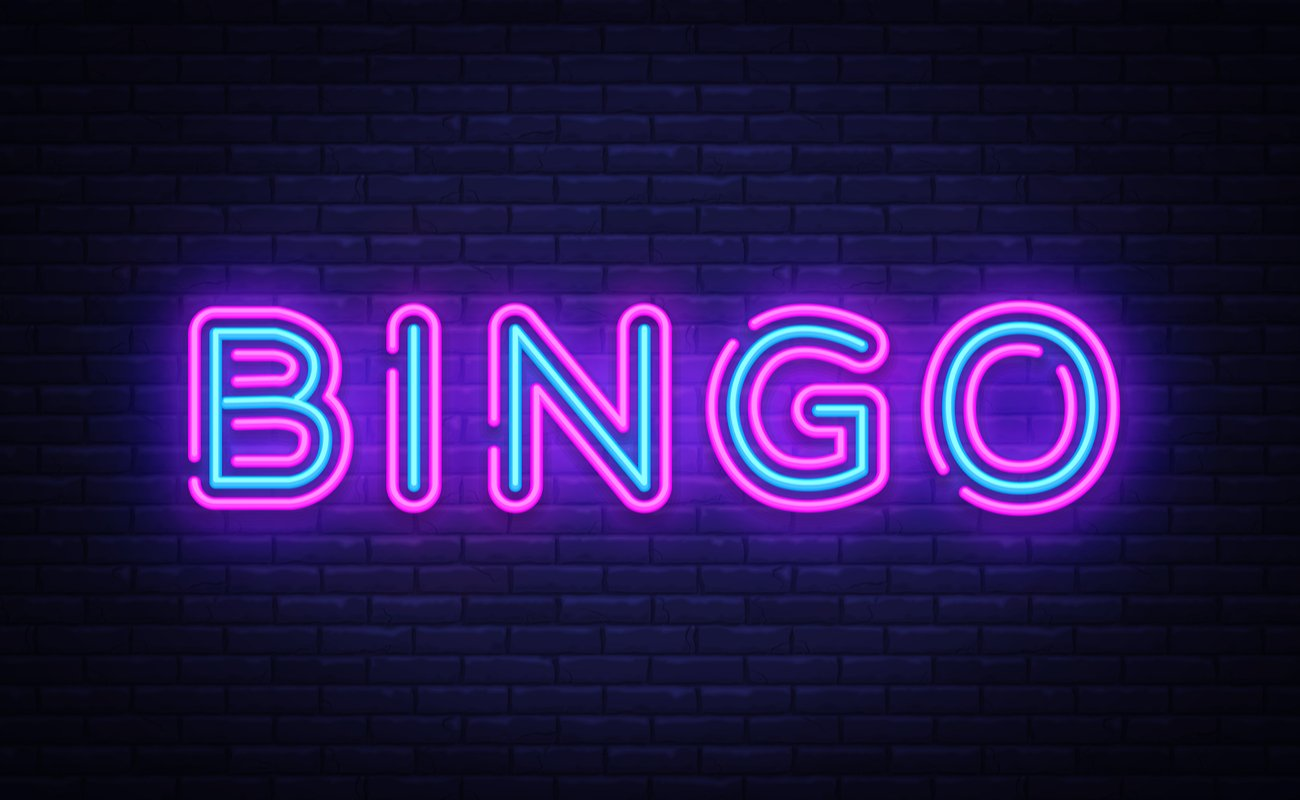 Bingo blue and pink neon sign on a brick wall