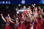 Jordan Henderson of Liverpool lifts the Champions League Trophy after winning the UEFA Champions League Final between Tottenham Hotspur and Liverpool at Estadio Wanda Metropolitano on June 01, 2019 in Madrid, Spain.