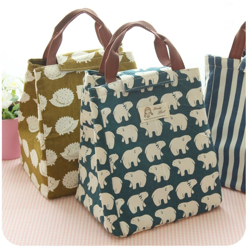 Three fabric lunch bags with bear, stripe and hedgehog pattern
