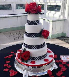 red and black polka dot wedding cake