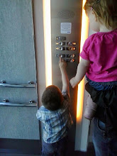 Photo: Going down in the lift, standard procedure for them both the press the buttons. Jake is understanding which letters means what now.