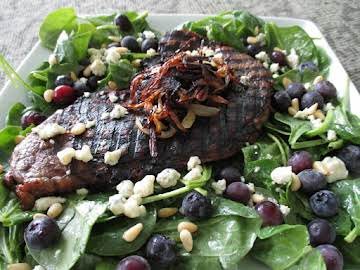 Steak and spinach salad with blueberries