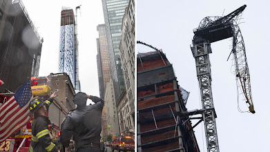 Photo: A FDNY firefighter and a New York police officer look up at a construction crane atop a luxury high-rise dangling precariously over the streets after collapsing in high winds from Hurricane Sandy, Monday, Oct. 29, 2012, in New York. Hurricane Sandy bore down on the Eastern Seaboard's largest cities Monday, forcing the shutdown of mass transit, schools and financial markets, sending coastal residents fleeing, and threatening a dangerous mix of high winds, soaking rain and a surging wall of water up to 11 feet tall. (AP Photo/John Minchillo)