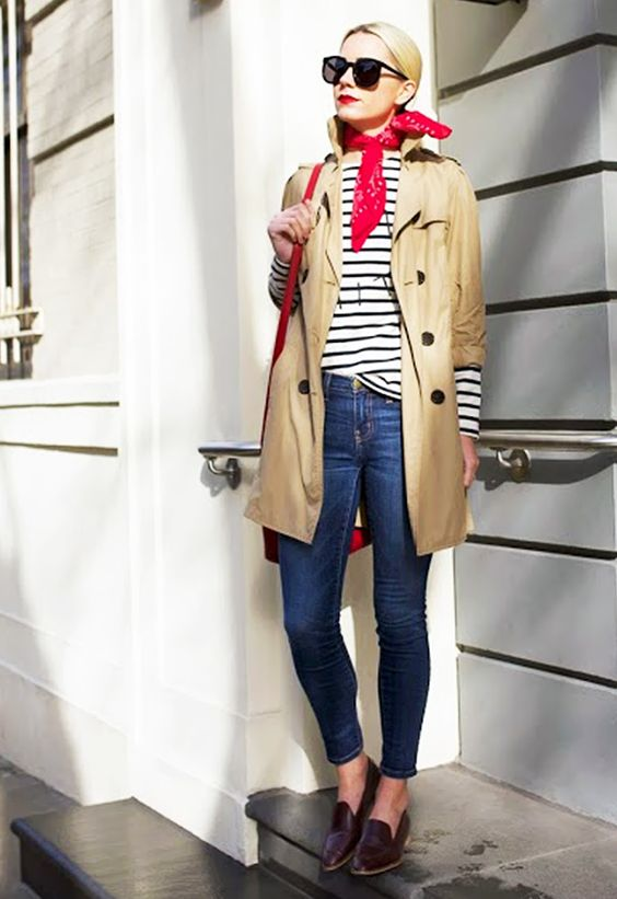 Parisian style outfit with neutral trench coat, nautical shirt, jeans and red scarf for Clear Spring women