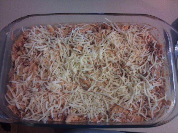 Spread 1 cup of spaghetti sauce in 13x9 baking dish.  Top with a...