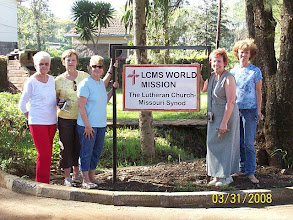 Photo: Team members with sign for the LCMS World Misison Offices