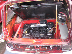 Photo: Here's the engine bay in mine - as found.  The engine cover insulation is in great shape. I've since restored the proper air cleaner system. Nice to find the original engine is still there and runs great!