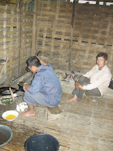 Photo: Preparing dinner - the fireplace as in all the local houses is just a sand pit on the floor with no chimney