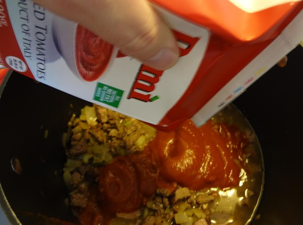 Pour broth, strained tomatoes, diced tomatoes and steak sauce into the pot. Stir. Add...