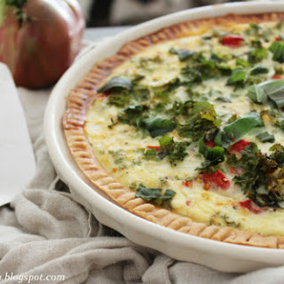 Vegetable Quiche Made With Fresh Tomatoes, Spinach, Basil and Goat Cheese