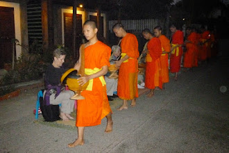 "Photo: The next morning we got up early and took part in an ancient Buddhist tradition of the ""alms-giving ceremony"", offering food to the monks."