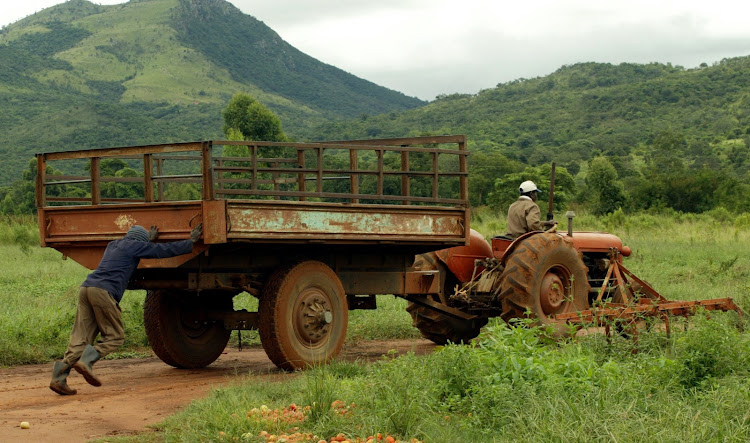 Edward Ramano pushes a tractor at his farm in Trichardtsdal, Limpopo. Pic: TEBOGO LETSIE/FILE PHOTO
