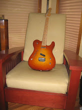 Photo: This thinline style solid body guitar was built for our youngest son Neil for his grad present with seymour duncan vintage pickups. Body made from mahogany and maple...neck was from a fender G&L tribute. Maybe one day I will make a home built neck for this one. Stickley style chair made from maple veneered MDF.