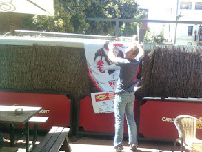 Photo: Wannabee Swannie, Trent Smith from theThailand Tigers puts up the Swannies' banner.