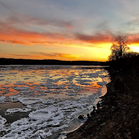 Fire and Ice by Michael Smith - Landscapes Sunsets & Sunrises ( winter, ice flow, sunset, ice, missouri river, river )