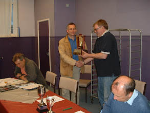 Photo: Nationwide captain Sven Zeidler receives the 2010-11 Wiltshire-4-A-Side League Trophy from Johnathon Bourne.