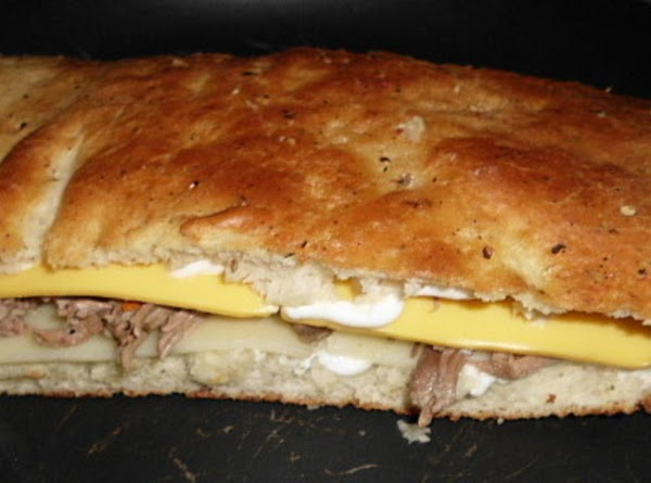Heat up leftover beef (or chicken), slice foccacia bread in half, and spread on...