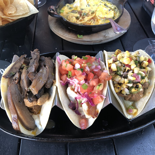 From left to right: sliced steak and mushroom taco, crispy Baja fish taco (grilled instead of fried), carne asada taco