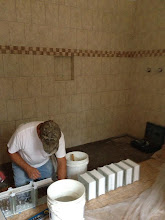 Photo: December 10, 2012 Erecting the glass block wall for the shower room in the master bath. Photo by Lake Weir Living