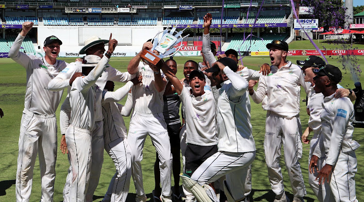The Hollywoodbet Dolphins cricket players celebrate after beating the Titans in the final of the 4-Day Domestic Series.