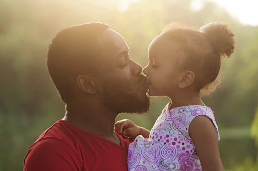 Many fathers are embracing the responsibility of staying home to raise their children while their partners are out labouring at work.
