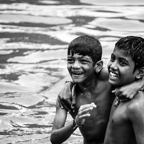 Happy by Rajarshi Chowdhury - People Portraits of Men ( water, drenched, bathing, friends, laugh, happy, boys, emotions, bath, children, smile )