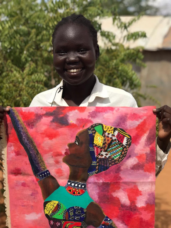Nyamouch Hoth, 21, displays her drawing