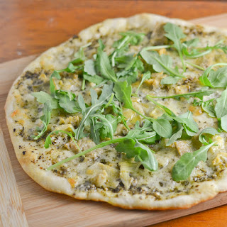 Artichoke, Mozzarella and Arugula Pesto Pizza.