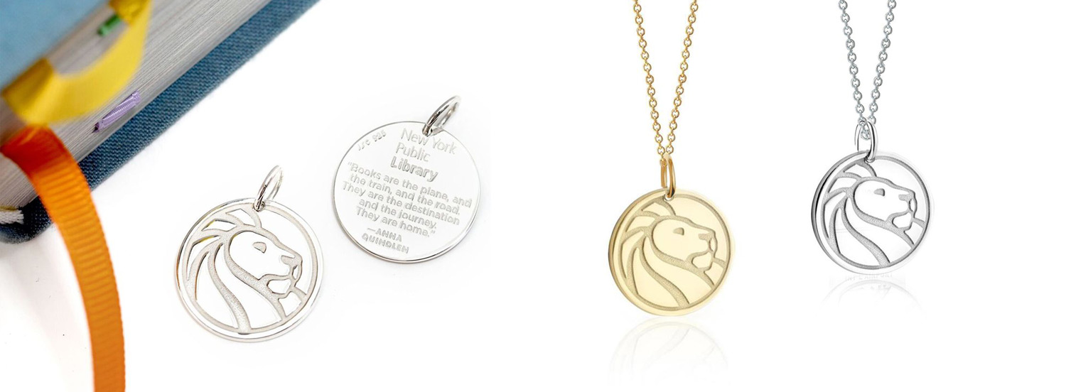 One gold necklace and one silver necklace, each with a charm featuring the New York Public Library lion logo