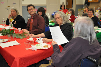 """Photo: Mary reads the """"little tree"""" Christmas poem by E. E. Cummings."""