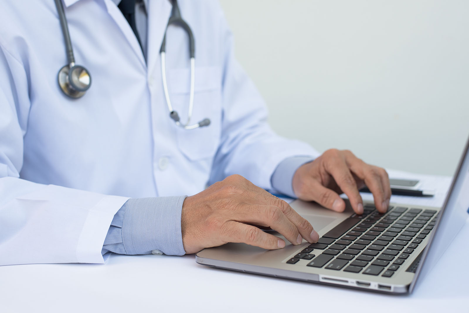Doctor sharing medical information on a computer