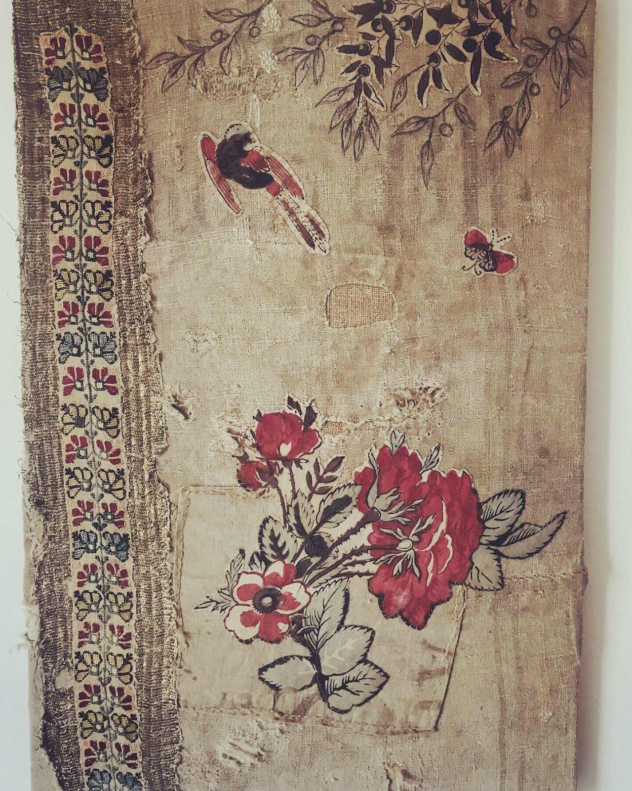 Textile picture with flower and butterfly