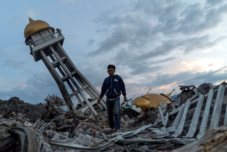 A resident walks at an area hit by the earthquake and tsunami in Palu, Central Sulawesi, Indonesia, October 4 2018. Picture: REUTERS/ATHIS PERAWONGMETHA