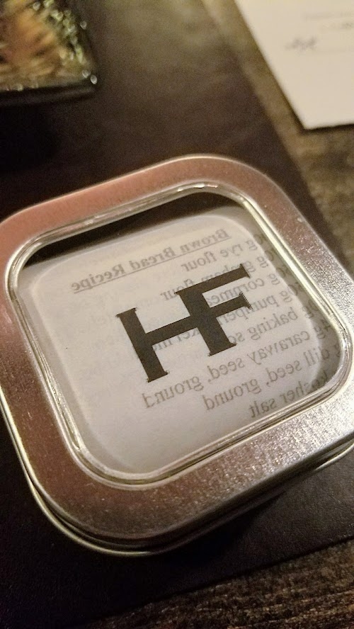 Holdfast Dining dinner ends with a tin of their homemade brown bread wrapped in the recipe for that bread