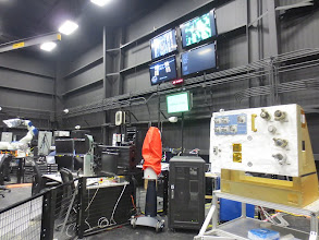 Photo: Control room, and to the right, another task board. On orbit, this sits atop ROSIE, but here on Earth they keep it sideways so nothing crashes on top of it...