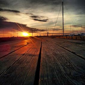 Sunset perspective by Julija Moroza Broberg - Landscapes Sunsets & Sunrises ( red, sky, sunset, harbour, pier, rays, sun )
