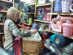 Photo: student gathering her weaving and warping yarns from the many to choose from , cottons and wools.
