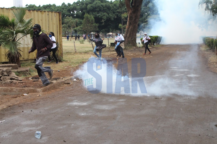 Activists are teargassed during a demonstration calling for arrest of coronavirus pandemic funds looters at Uhuru Park, Nairobi on August 21, 2020/ANDREW KASUKU