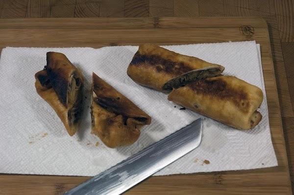 Cut each tortilla in half on an extreme bias.