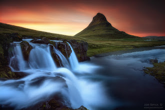 """Photo: """"Synchronicity"""" Kirkjufell, Iceland  When all elements combine on a single landscape, photons start creating music, and visual dreams suddenly become real.  José Ramos © http://www.joseramos.com  My second published Kirkjufell sunset shot. After sleeping inside the rental car in Keflavik (the plane arrived at 1am), I decided to head to Kirkujfell next day. I had seen this mountain so many times on 500px and other galleries, and yet it still kept me fascinated every single time with its singular shape, frequently adorned by beautiful waterfalls. As soon as I arrived I could feel my heart racing with the excitement, and I rushed to the spot and photographed it from many angles until it was absolutely dark.  I'm not one who likes to brag about being """"absolutely unique"""" on a certain place, creating his """"own interpretations"""" of a scene, just for the sake of setting myself apart from other photographers. This photo is a great example of that. A Kirkujfell photograph with the three waterfalls is an image beaten to death? Well, under the perspective of online photography addicts or people with giant budgets, most certainly yes, but still only about 0,0000001% of photographers have the chance to visit such place. This is so much more about showing visions of nature than showing ourselves...  Technical data:  Sony a77 + Sigma 10-20mm Aperture: f/11 Shutter speed: 30 seconds Focus: Manual (for hyperfocal distance) Wireless Remote Timer Filters. Formatt Hitech ProStop IRND 4 stops full ND, 3 stop soft ND Grad Manfrotto MT055XPRO3 tripod + MH055M0-Q6 ballhead  #icelandphotography  #kirkjufell  #landscapephotography  #landscapephoto  #longexposurephotography  #mountainphotos  #sunsetphotography  #sunsetphotos  #sunsetlovers  #waterfallphotography  #waterfallwednesday  #photooftheday  #photoextract  #photomaniaglobal  #stunningmoment"""
