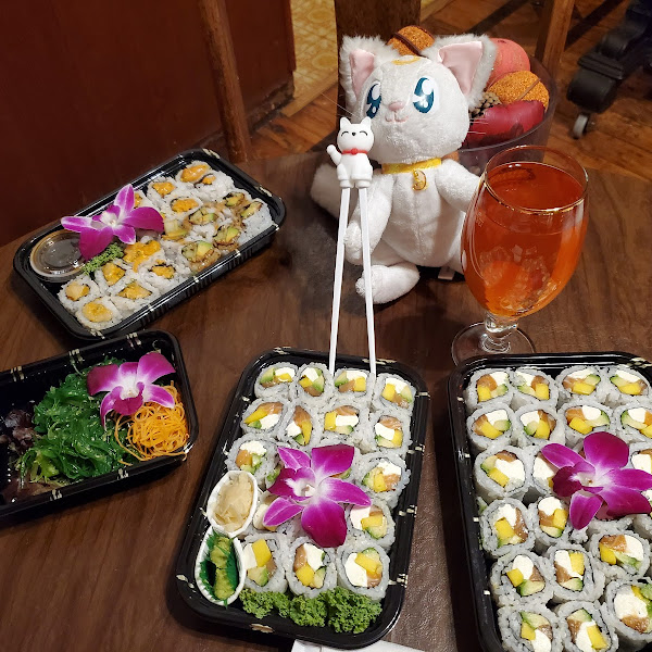Artemis is waiting to share his meal with Luna and Diana. mango cream cheese avacdo salmon roll...eel cucumber avocado roll spicy white tuna...and spicy salmon rolls