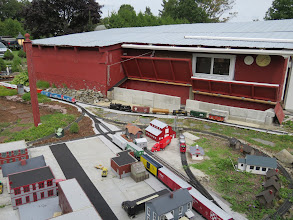 Photo: John Joy's train with 2 custom made cars.  Water or tank car, and the Vermont Railway boxcar.  Peter's Grand Trunk train with custom built sawdust cars and some TOFC carring St Johnsbury Trucking traliers