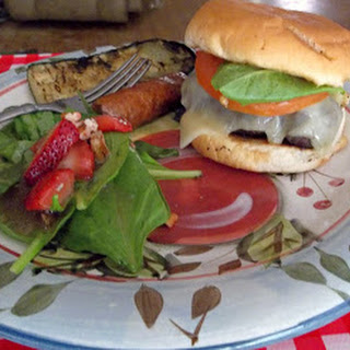 Spicy Creole Burger with spinach and strawberry salad,