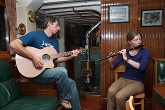 Photo: Back on board the ship, we bugged Luke and Miray enough until they gave us a concert of Irish music.