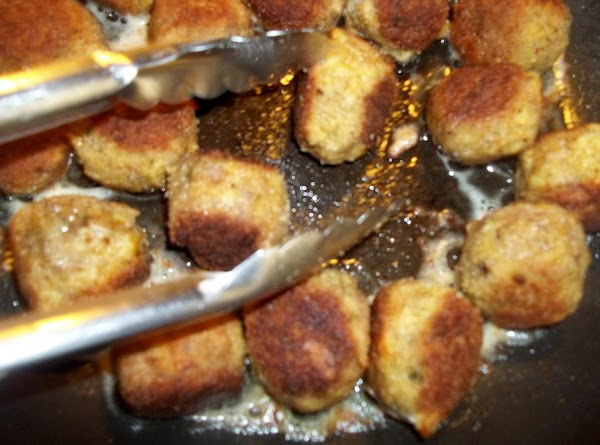 Dip meatballs into egg, then coat with crumbs.   In a large skillet, cook meatballs...